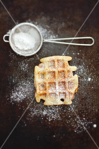 A waffle with icing sugar