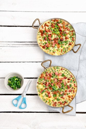 Frittatas with chanterelle mushrooms, peas and bacon