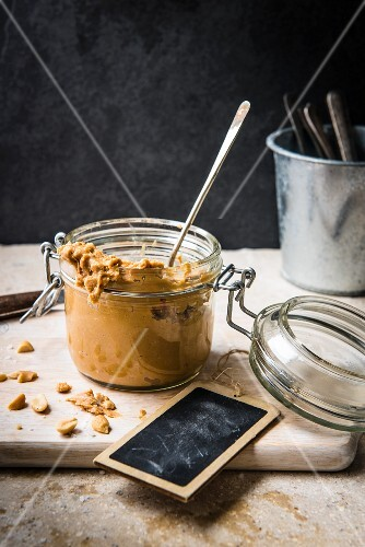 Homemade peanut butter in a flip-top jar
