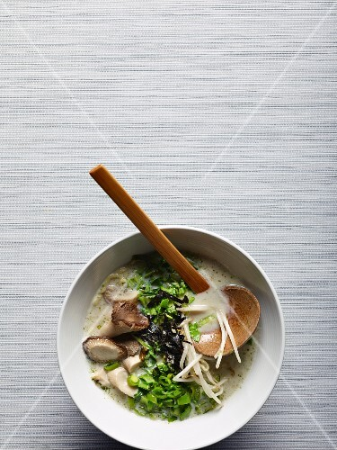 Vegetarian ramen soup with mushrooms, ramen noodles, algae, mung bean sprouts and bok choy