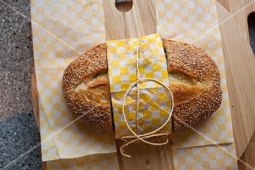 Sesame seed bread on a wooden board