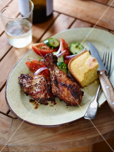 Smoked jerk chicken with corn bread and salad