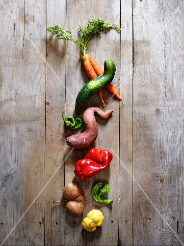 Wonky vegetables on a wooden surface