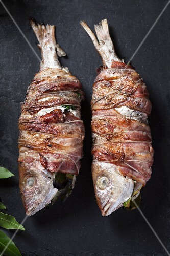 Fried fish wrapped in bacon