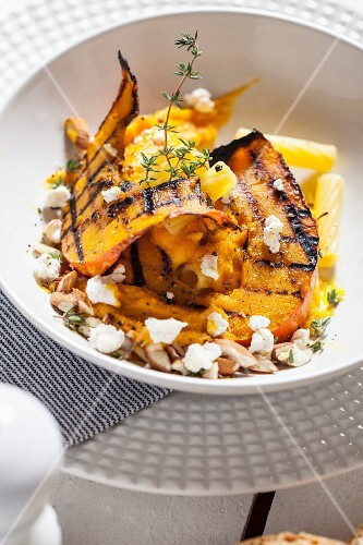 Penne pasta with grilled pumpkin and thyme