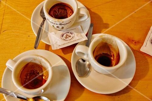 Three used espresso cups