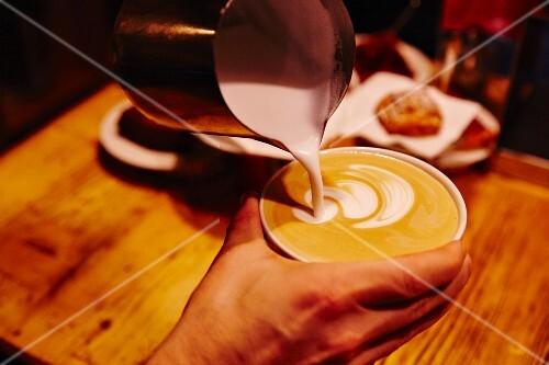 A milk pattern being made in coffee, Munich