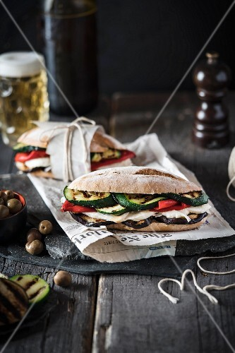 Grilled vegetable and mozzarella sandwiches served with beer