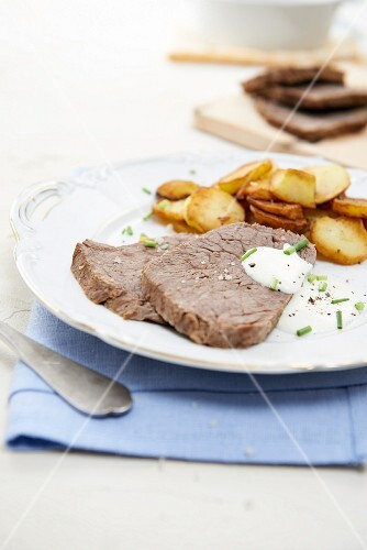 Prime boiled beef with fried potatoes and horseradish sauce
