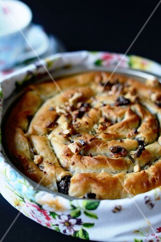 Poppyseed cake in a baking dish with a floral scarf