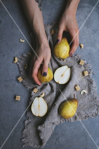 A woman taking pears