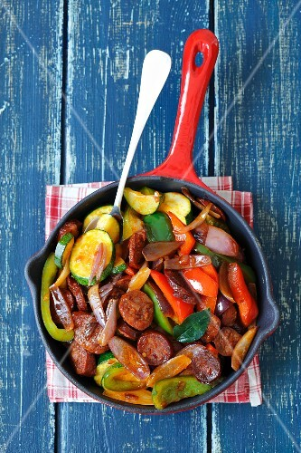 Fried chorizo with onions, peppers and courgettes