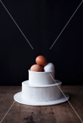 Chickens eggs in a two-tier porcelain container
