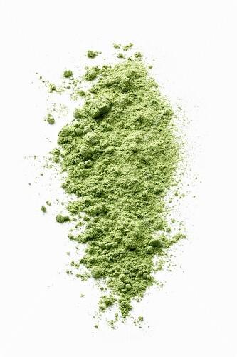 Wheatgrass powder on a white surface