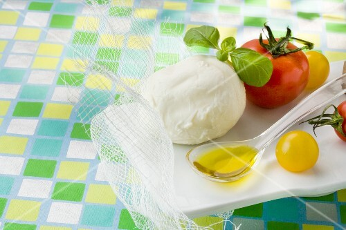 Ingredients for mozzarella with tomatoes and basil