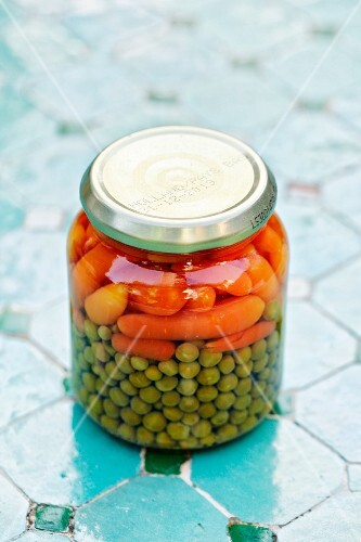 A jar of peas and carrots