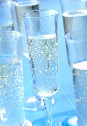 Champagne glasses on a blue surface