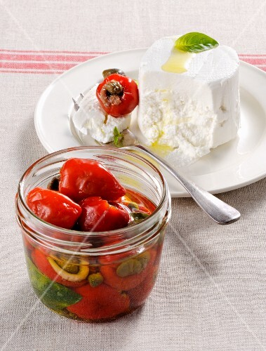 Goat's cheese and stuffed, preserved mini peppers