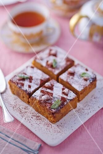 Gateau with hazelnut mousse and icing sugar
