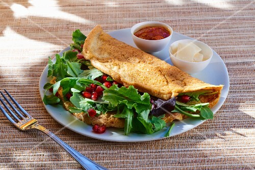 Omelette with rocket and pomegranate seeds