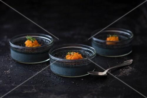 Black crème brûlée with apricot confit and sesame seeds