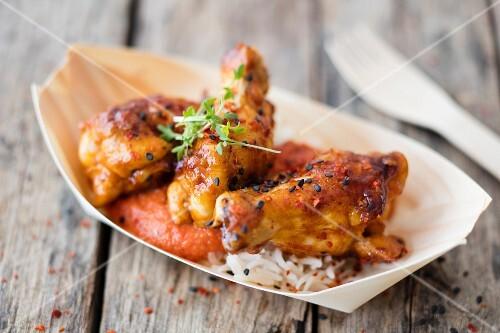 Jerk chicken served in a palm leaf dish (Jamaica)