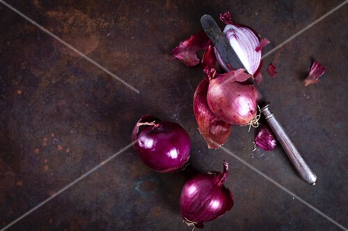 Red onions with a knife