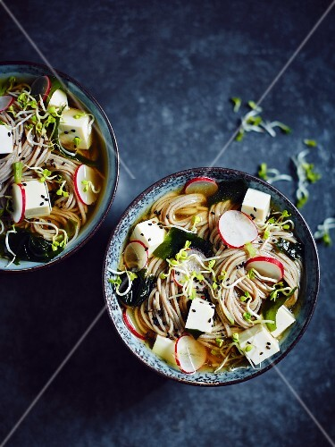 Buckwheat noodle soup with tofu, radishes, black sesame seeds, algae and cress (Japan)