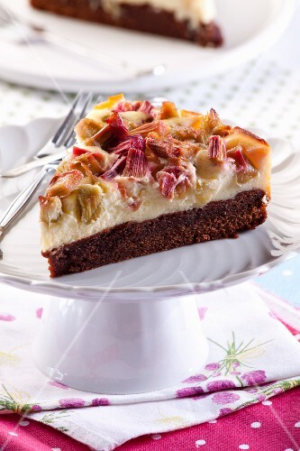 A slice of chocolate cheesecake with rhubarb