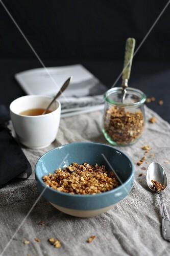 Muesli and tea on a breakfast table