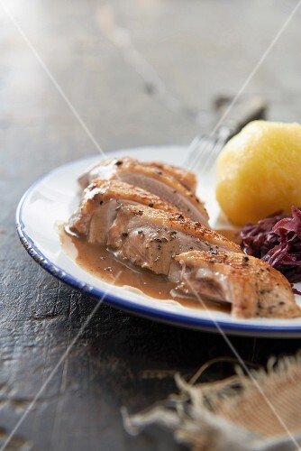 Duck with dumpling and red cabbage