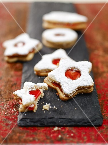 Jammy shortbread biscuits on a slate platter