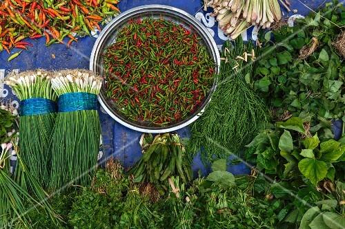 Fresh herbs and vegetables at a market in Luang Prabang, Laos