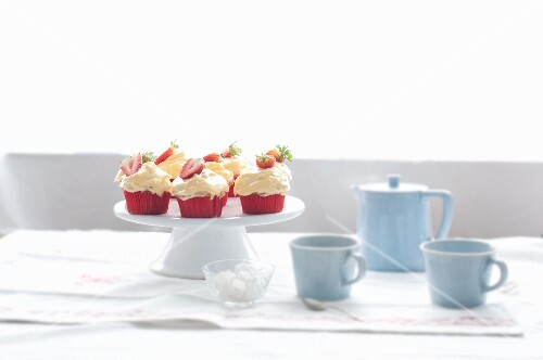 Strawberry pudding cupcakes on a cake stand