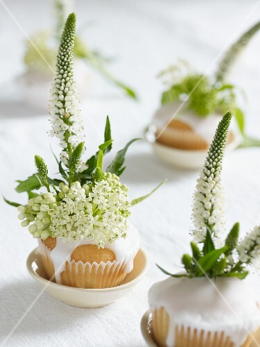 White cupcakes decorated with flowers