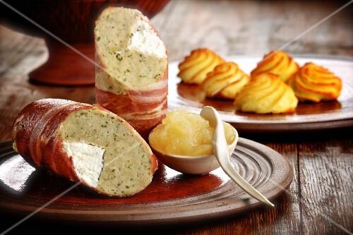 Stuffed bacon rolls with apple sauce