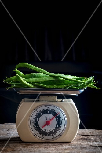 Green beans on a pair of old kitchen scales