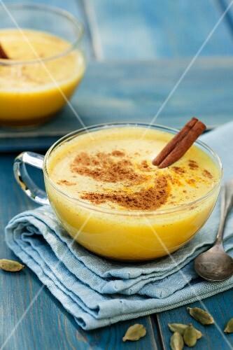 Turmeric latte with cinnamon and cardamon (vegan)