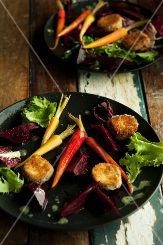 Breaded, baked cheese fritters with beetroot and carrots