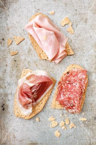 Crispy schiacciatine topped with salami, ham and mortadella