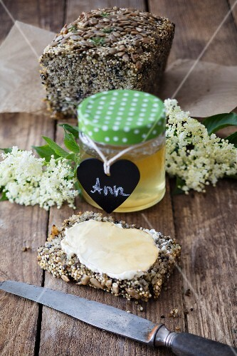 Homemade elderflower jelly on fresh quinoa bread