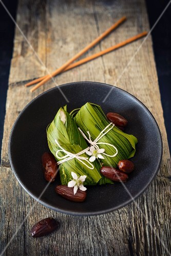 Zong Zi (bamboo parcels filled with sweet sticky rice and date for a Dragon Boat Festival, China)