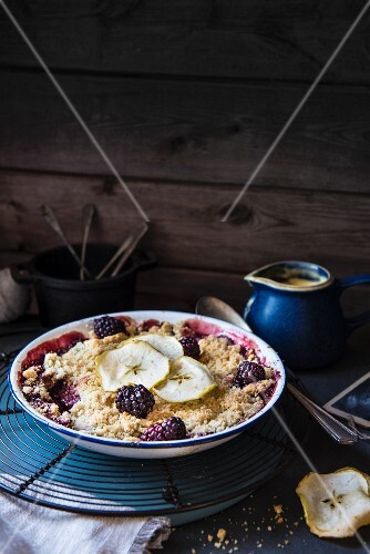 Blackberry and apple crumble served with custard
