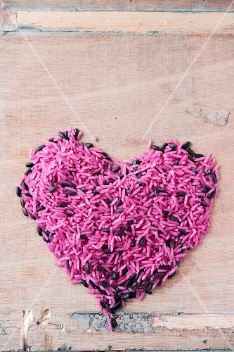 Heart made from pink and black rice (top view)