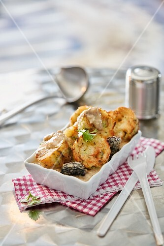 Napkin dumplings with a morel mushroom sauce