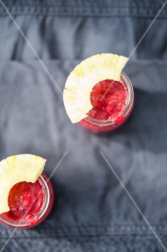 Smoothies made with raspberries, strawberries and pineapple (seen from above)