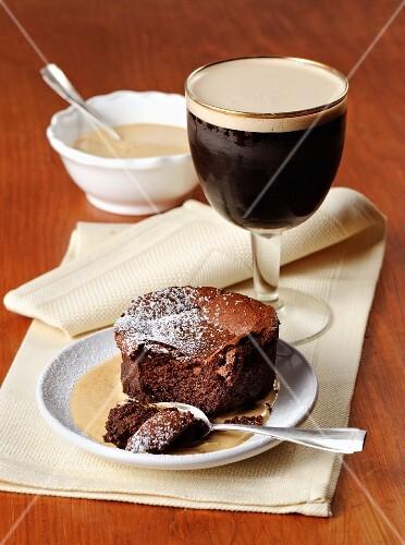 Chocolate cake with vanilla sauce and Irish coffee