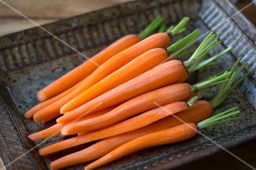 Peeled carrots on a tray