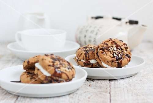 Chocolate biscuits with hazelnuts filled with quark