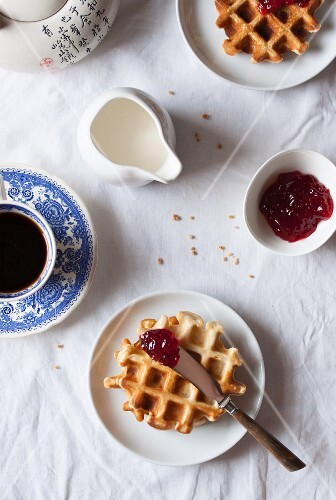 Cornflour and spelt waffles with raspberry jam served with coffee